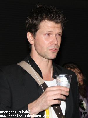 Mathias Edenborn mit Sektbecher